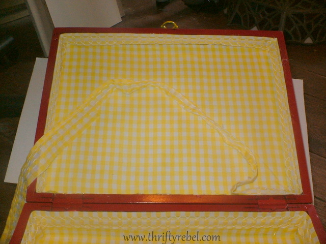 Lining inside of cutlery chest sewing box with fabric