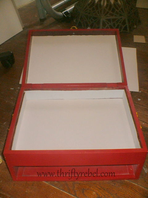 Lining inside of cutlery chest sewing box with cardboard