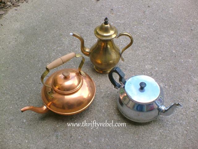 three-metal-teapots
