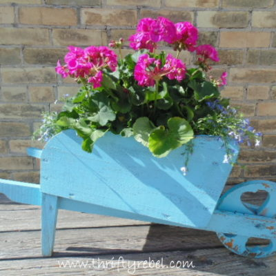 Easy Distressed Wheelbarrow Planter