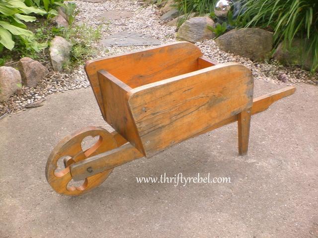 Distressed Wooden Wheelbarrow Planter Makeover