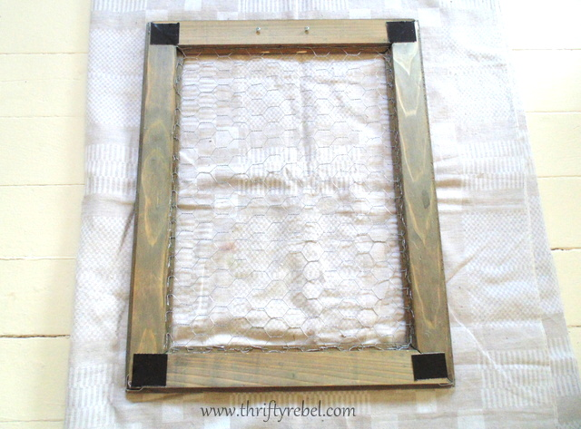 Attaching chicken wire to back of barnboard frame for framed ornament tree display