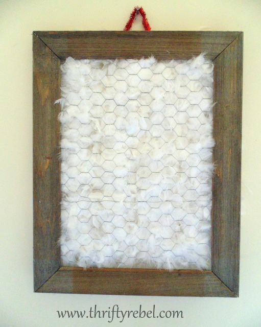 Covering back of barnboard and chicken wire frame with white feather boa for framed ornament tree display