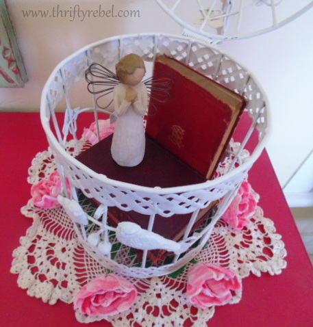 Repurposed birdcage makeover for book display