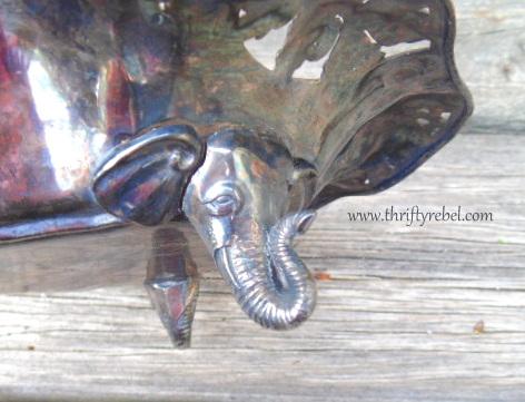 vintage metal dish with elephant head feet