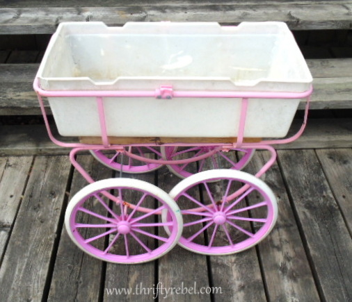 Vintage doll carriage planter