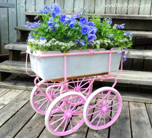 Pink doll carriage planter