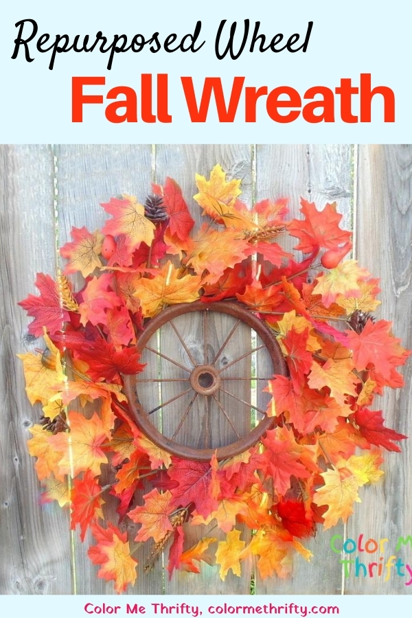 Create a quick and easy fall wreath with a repurposed wheel and some dollar store fall leaves