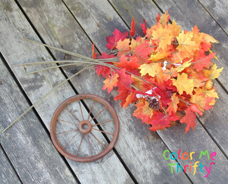 fall wreath from repurposed wheel and plastic leaves