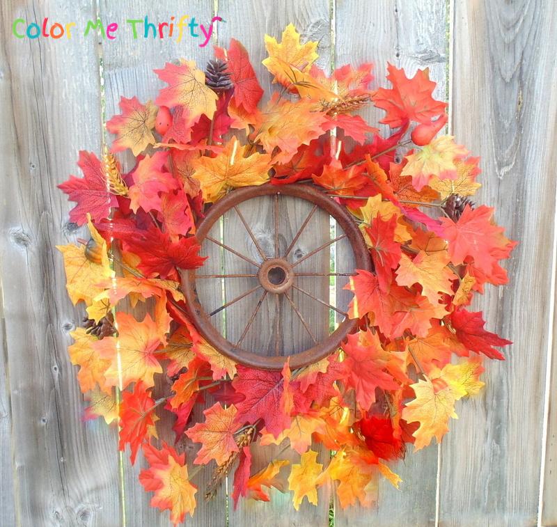 repurposing a rusty wheel into a fall wreath