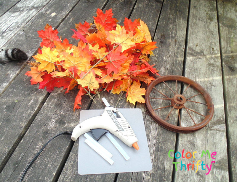 supplies to create fall wreath from repurposed wheel