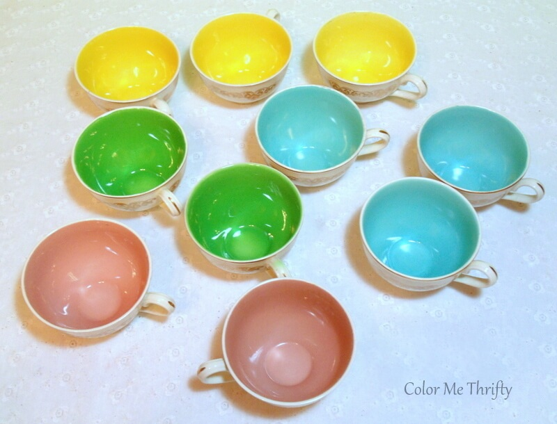 collection of colorful teacups used to create repurposed teacup pumpkin