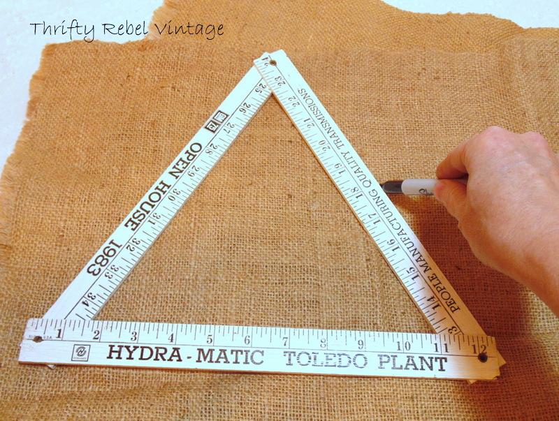 Marking outline of Folding Ruler Christmas Tree on natural burlap with black marker
