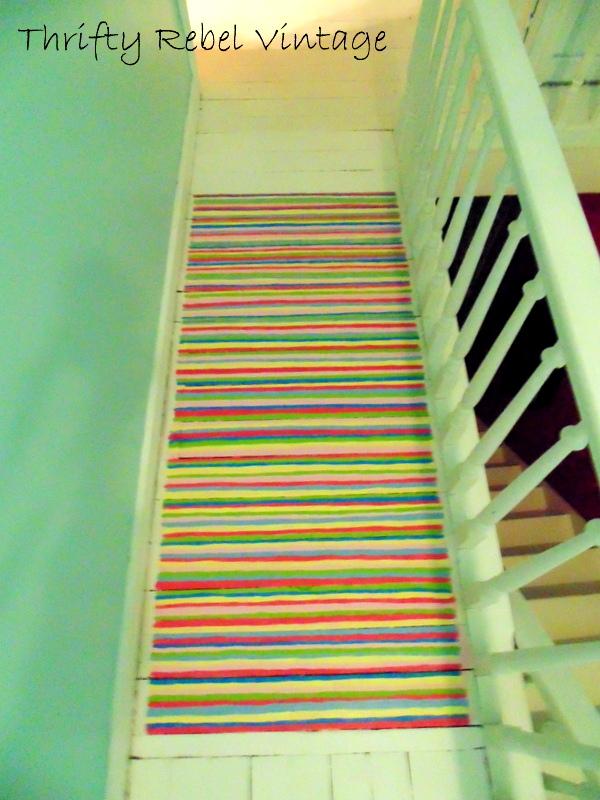 painted rag rug before fringe