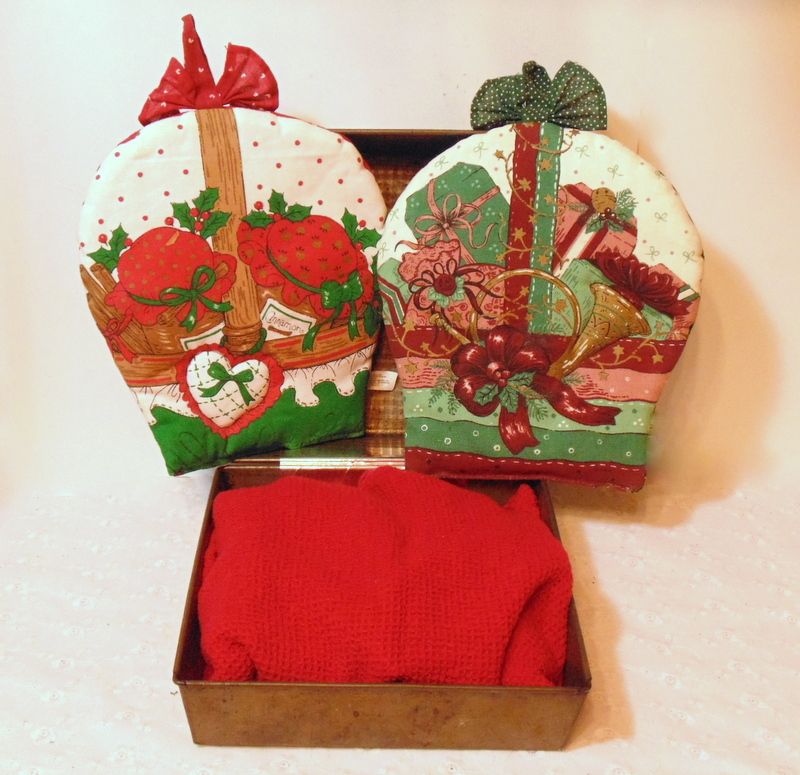 Filling a repurposed vintage baking pan gift box with kitchen linens
