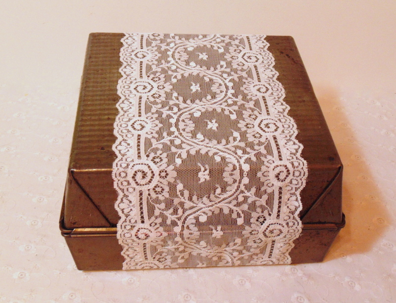 Wrapping lace around vintage baking pan gift box