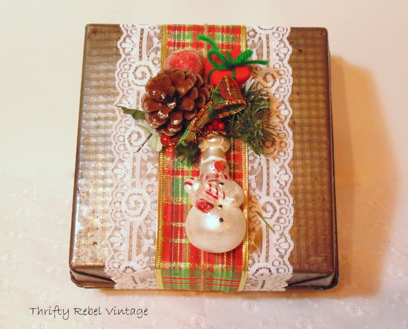 Ribbon and lace on vintage baking pan gift box