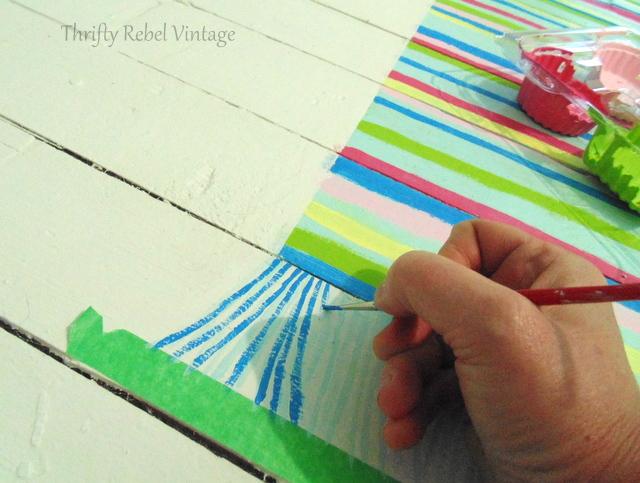 Painting dark colour fringe on faux rag rug