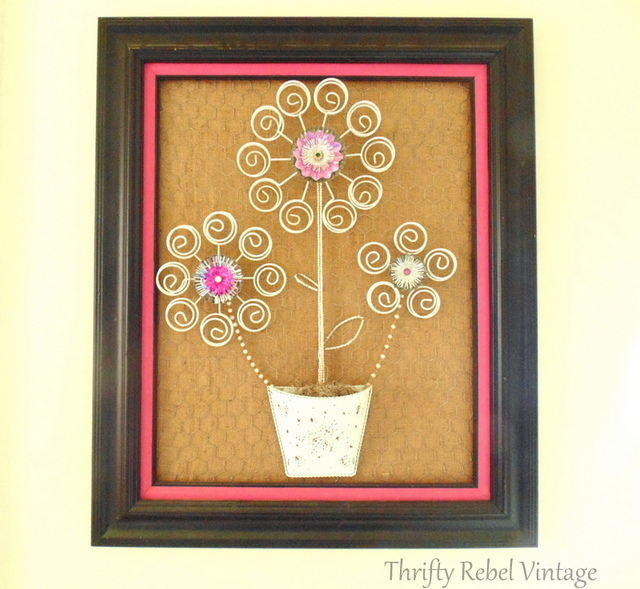 Repurposed tealight tree stand flower art
