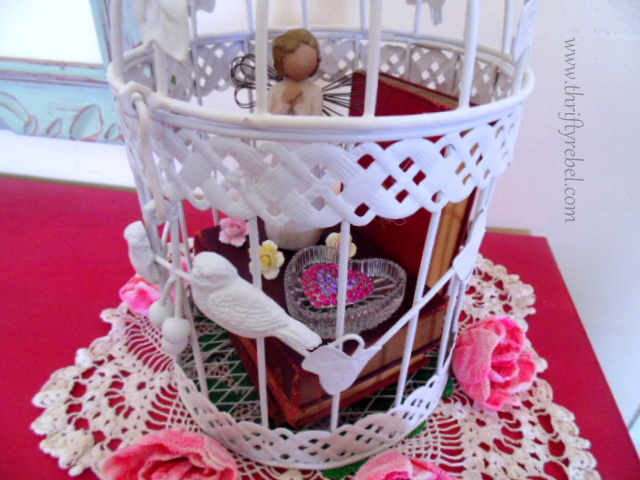 antique miniature book collection inside decorative birdcage