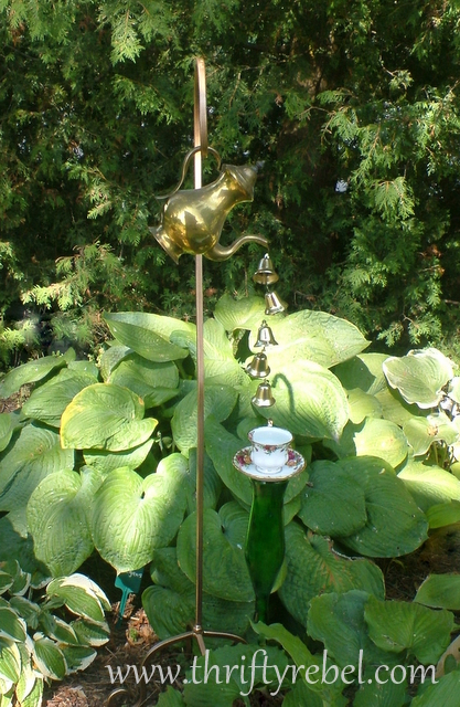 vintage coffee pot on shepherd hook garden wind chime
