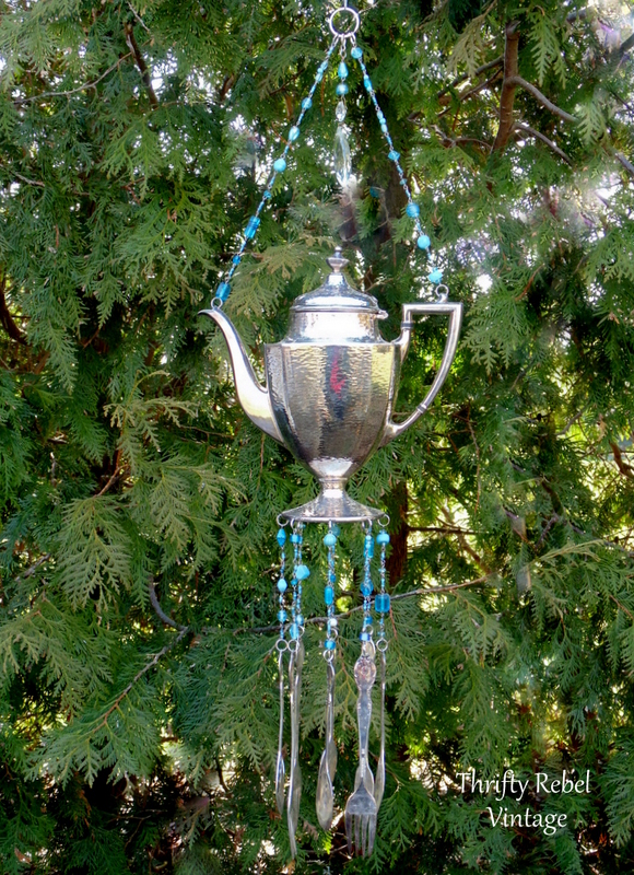 vintage silver teapot and silverware wind chime with blue beaded necklace