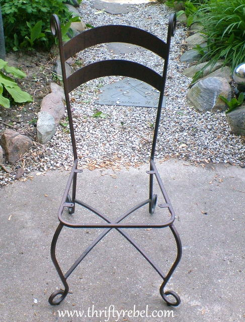 vintage metal chair with curlicue feet