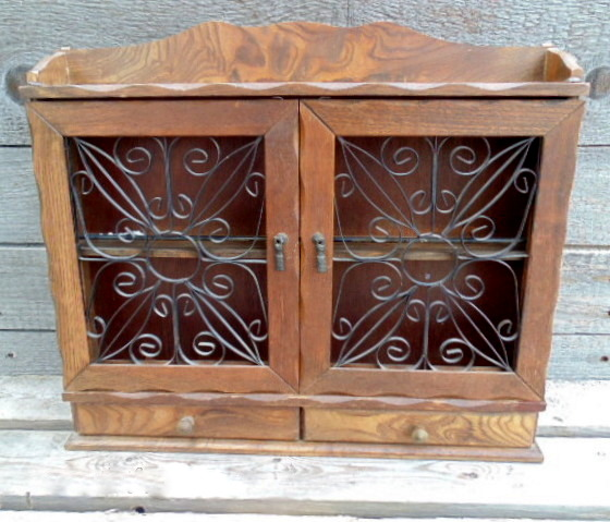 vintage wooden spice rack shelf with wrought iron door inserts
