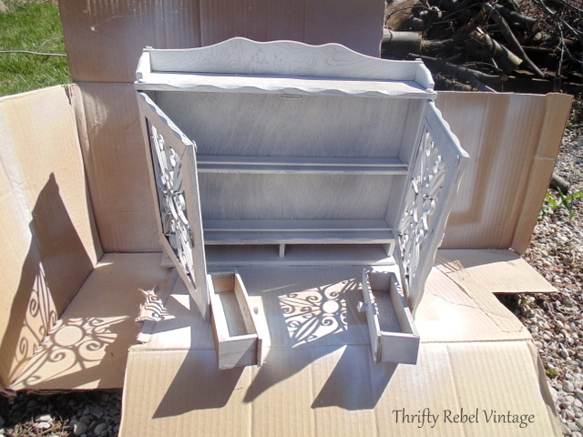 spray painting a vintage wooden spice rack shelf