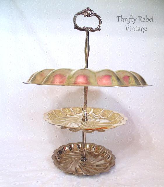 repurposed metal tiered stand into triple decker hanging bird feeder