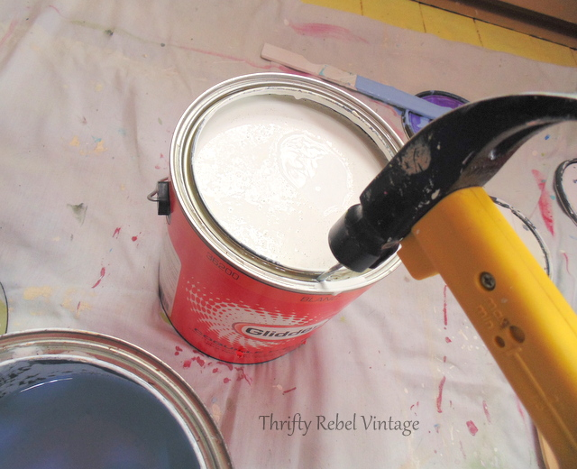 hammering holes in paint can to help paint drip back into can