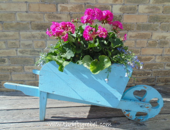 Wooden wheelbarrow planter makeover