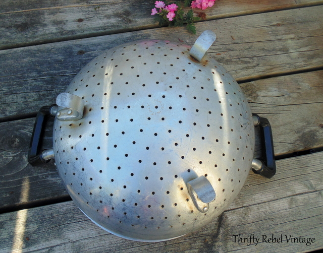 vintage metal strainer repurposed into a planter