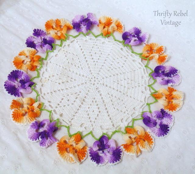 handmade orange and purple pansy crochet doily