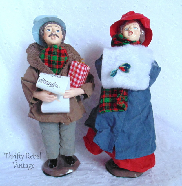 man and woman Christmas carollers