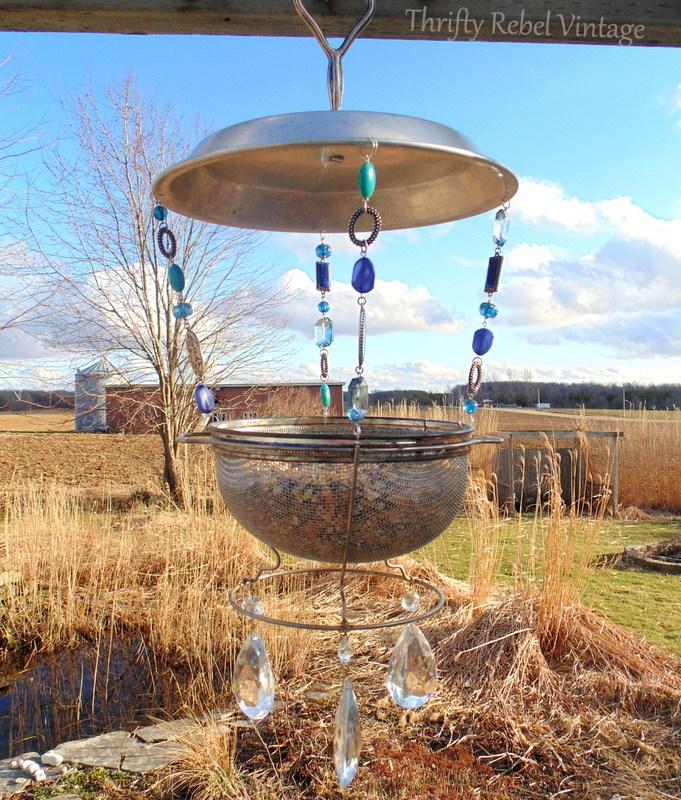 repurposed vintage sieve bird feeder