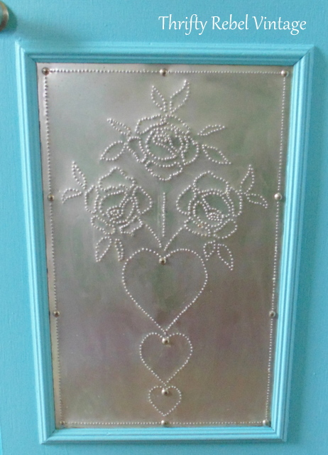 painting molding around punched tin panel