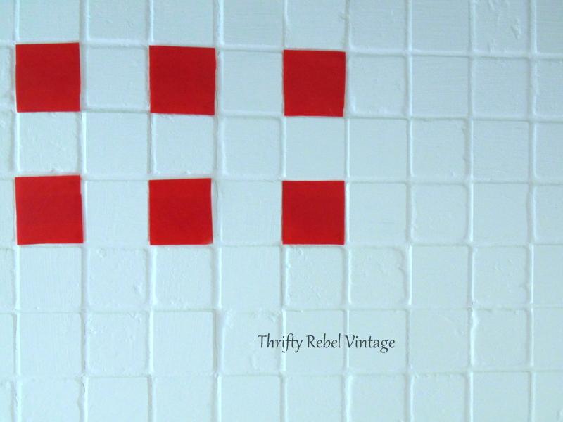 applying electrical tape faux tiles for kitchen backsplash makeover