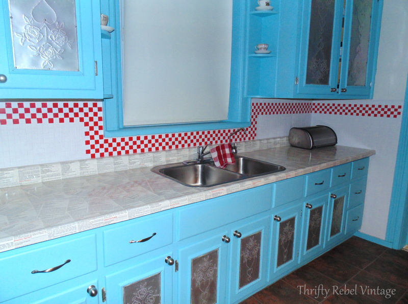 Decoupaged kitchen counter and kitchen backsplash makeover using electrical tape faux tiles