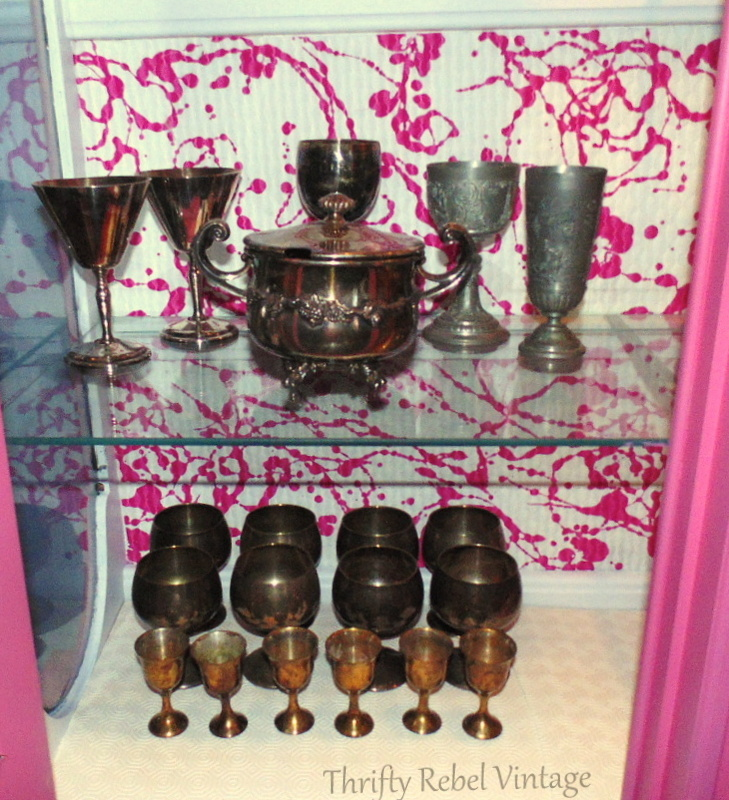silver goblet collection in living room china cabinet