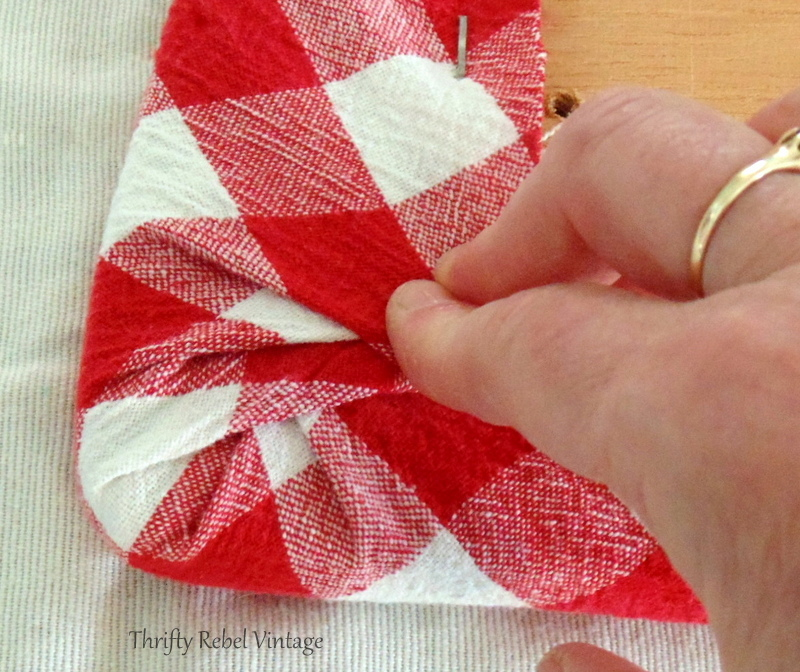 how to tuck in the corners of fabric for kitchen chair seat makeover