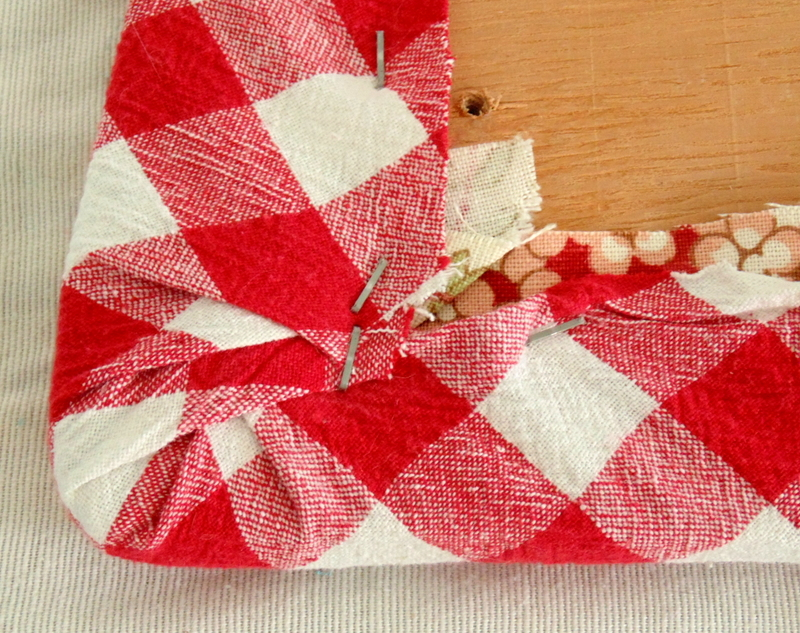 using staple gun to fabric for kitchen chair makeover