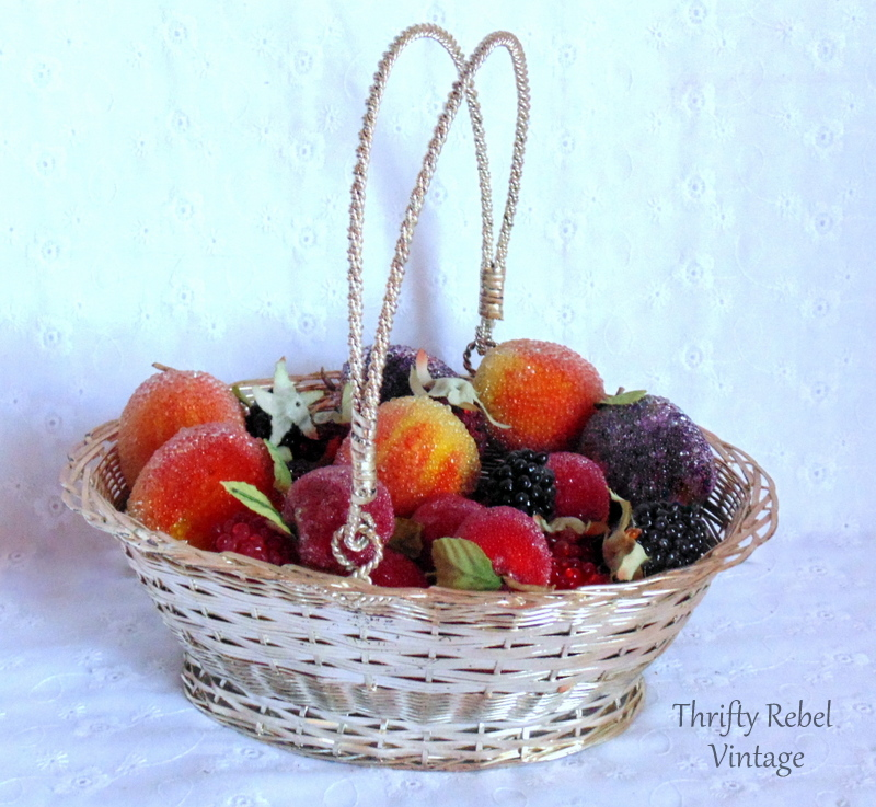 basket of beaded plums cherries and berries
