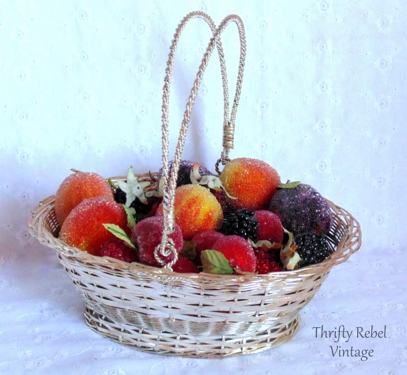basket of beaded plums cherries and berries