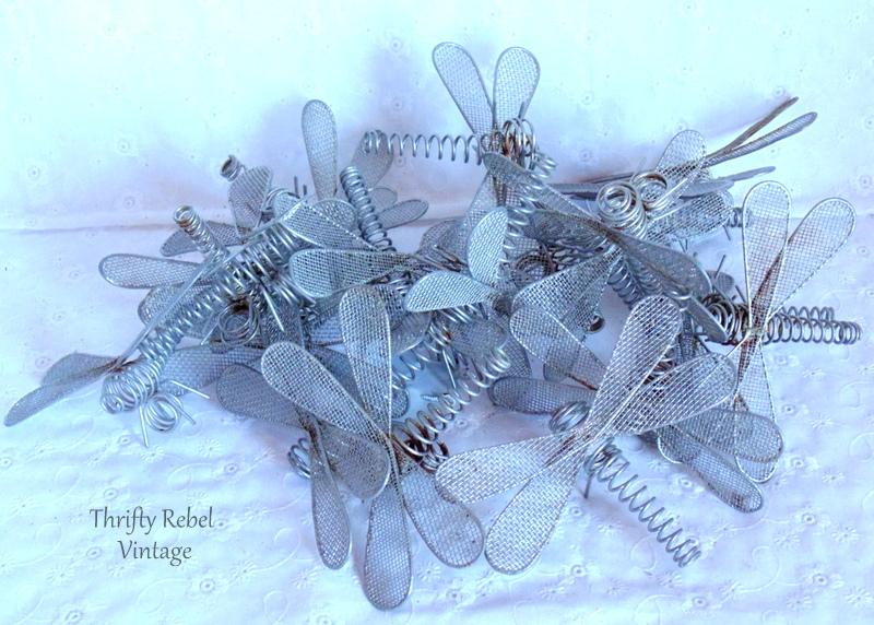 silver metal dragonflies