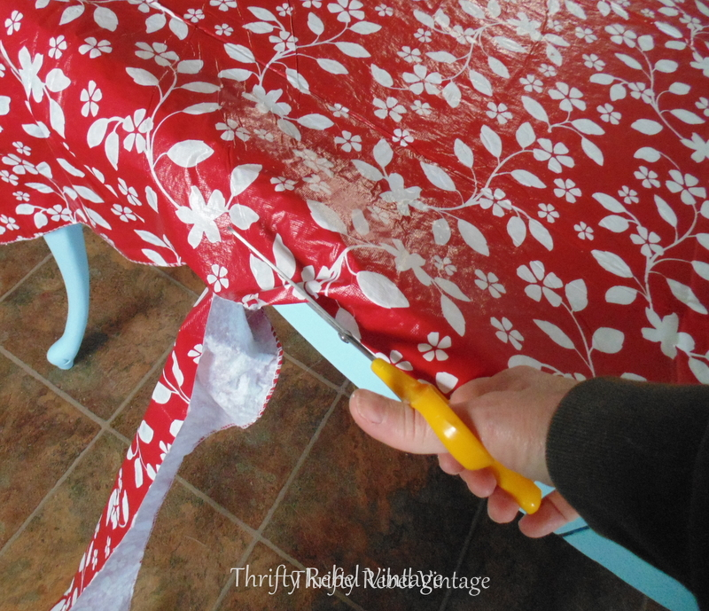 cutting vinyl tablecloth for kitchen table makeover