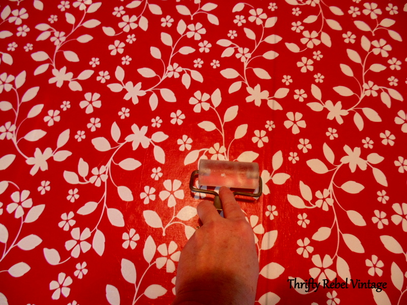 using a breyer to smooth out vinyl tablecloth for kitchen table makeover