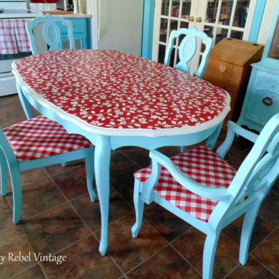 decoupaged vinyl tablecloth for kitchen table makeover