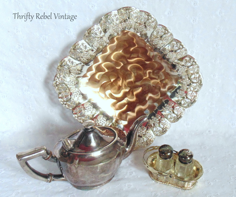 silver tray, teapot, and mini salt and pepper set