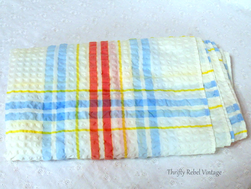 blue red yellow and white striped tablecloth